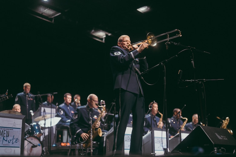Tech. Sgt. Kevin Cerovich, U.S. Air Force Band's Airmen of Note trombonist, performs a solo during a show at the Davidson Fine Arts School Theatre in Augusta, Ga., May 25, 2017. The band performed four concerts for audiences throughout Augusta, Athens and Savanna, Ga., all leading up to their final concert at the Jacksonville Jazz Festival. (U.S. Air Force photo by Senior Airman Delano Scott)
