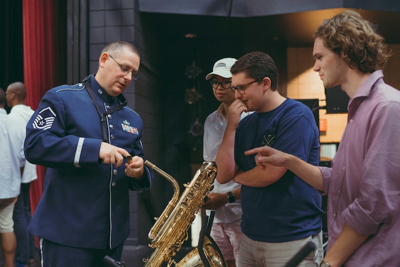 Master Sgt. Douglas Morgan, U.S. Air Force Band's Airmen of Note trombonist baritone saxophonist, shares details about his instrument with audience members after a performance at the Davidson Fine Arts School Theatre in Augusta, Ga., May 25, 2017. The Airmen of Note's mission is to honor those who have served, inspire American to heightened patriotism and service, and positively impact the global community on behalf of the Air Force. (U.S. Air Force photo by Senior Airman Delano Scott)