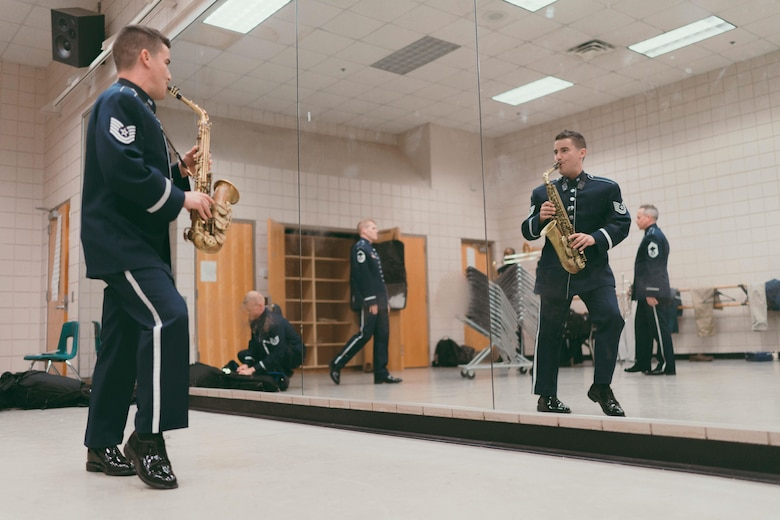 Tech. Sgt. Michael Cemprola, U.S. Air Force Band's Airmen of Note saxophonist, plays his instrument prior to a performance at the Fine Arts Auditorium in Savannah, Ga., May 26, 2017. The band performed for more than 8,000 people over the course of their tour throughout Georgia and Florida. (U.S. Air Force photo by Senior Airman Delano Scott)