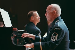 Master Sgt. Steven D. Erickson, U.S. Air Force Band's Airmen of Note pianist, performs at the Fine Arts Auditorium in Savannah, Ga., May 26, 2017. The band played a variety of contemporary jazz pieces throughout each performance, all having a distinctive tie to the armed forces. Each piece of music was written, arranged or performed by service members. (U.S. Air Force photo by Senior Airman Delano Scott)
