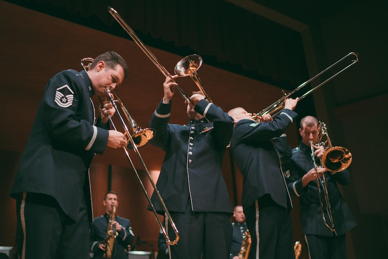U.S. Air Force Band's Airmen of Note trombonists perform a song at the Fine Arts Auditorium in Savannah, Ga., May 26, 2017. The band played a variety of contemporary jazz pieces throughout each performance, all having a distinctive tie to the armed forces. Each piece of music was written, arranged or performed by service members. (U.S. Air Force photo by Senior Airman Delano Scott)
