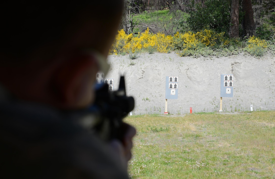 Staff Sgt. Blake McCartney, 627th Security Forces Squadron command support staff, aims an M-4 Carbine rifle at a target May 31, 2017, during the Elementary Level Rifle Excellence Competition at Joint Base Lewis-McChord, Wash. More than 100 Airmen from JBLM competed in the competition for the U.S. Air Force Excellence in Competition Rifleman Badge. (U.S. Air Force photo/Senior Airman Jacob Jimenez)