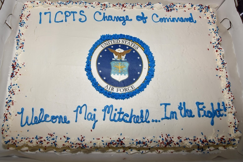 A decorated cake sits on display during the 17th Comptroller Change of Command ceremony at the Event Center on Goodfellow Air Force Base, Texas, June 2, 2017. The event welcomed its new commander Maj. Nelson Mitchell. (U.S. Air Force photo by Staff Sgt. Joshua Edwards/Released)