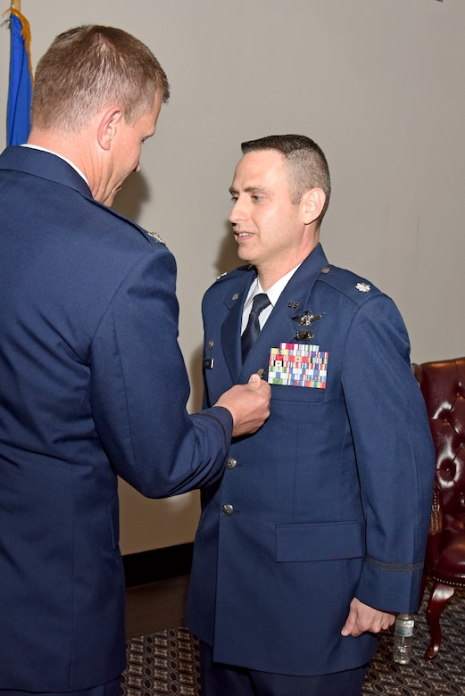 U.S. Air Force Lt. Col. Edward Harris, 17th Comptroller Squadron Commander, stands at attention as Col. Jeffery Sorrell, 17th Training Wing Vice Commander, pins on a Meritorious Service medal during the 17th CPTS Change of Command ceremony at the Event Center on Goodfellow Air Force Base, Texas, June 2, 2017. Harris received the medal for outstanding service to the wing. (U.S. Air Force photo by Staff Sgt. Joshua Edwards/Released)