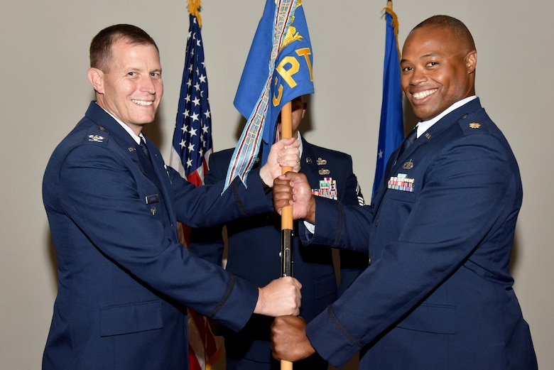 U.S. Air Force Maj. Nelson Mitchell, the new 17th Comptroller Squadron Commander, takes the guideon from Col. Jeffery Sorrell, 17th Training Wing Vice Commander, during the 17th CPTS Change of Command ceremony at the Event Center on Goodfellow Air Force Base, Texas, June 2, 2017. Mitchell previously served as the Air Force Installation and Mission Support Center deputy of budget operations at Joint-Base San Antonio. (U.S. Air Force photo by Staff Sgt. Joshua Edwards/Released)