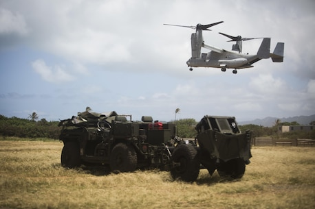 An MV-22 Osprey aircraft with Marine Medium Tiltrotor Squadron 268 prepares to land at Boondocker Training Area in support of a 1st Battalion, 12th Marine Regiment training exercise aboard Marine Corps Base Hawaii on May 31, 2017. The training exercise involved transporting an Internal Transport Vehicle and a 120mm mortar system to aid in direct support of infantry units. (U.S. Marine Corps photo by Lance Cpl. Matthew Kirk)