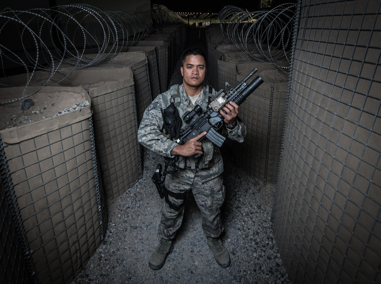 U.S. Air National Guard Staff Sgt. Neil Carranza, a personnel search area lead with the 407th Expeditionary Security Forces Squadron, stands for a photo May 10, 2017, at the 407th Air Expeditionary Group. As a screener, Carranza ensures only authorized individuals are gaining access to the installation and checks for contraband, drugs or illegal items. Carranza, a traditional guardsman with the 254th Security Forces Squadron at Andersen Air Force Base, Guam, deployed in support of Operation Inherent Resolve. (U.S. Air Force photo by Staff Sgt. Alexander W. Riedel)