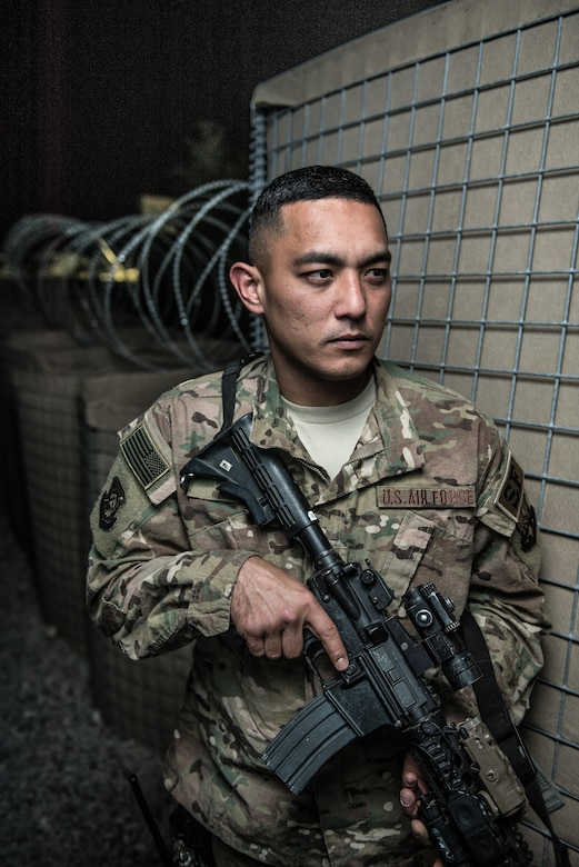 U.S. Air National Guard Staff Sgt. Ricky Meno, a vehicle search area lead with the 407th Expeditionary Security Forces Squadron, stands with his M4 carbine for a photo May 10, 2017, at the 407th Air Expeditionary Group. Meno's team ensures only authorized personnel and vehicles enter the installation by providing vehicles search and additional overwatch via towers, cameras and other sensors covering the area. Meno, a traditional guardsman with the 254th Security Forces Squadron at Andersen Air Force Base, Guam, deployed in support of Operation Inherent Resolve. (U.S. Air Force photo by Staff Sgt. Alexander W. Riedel)