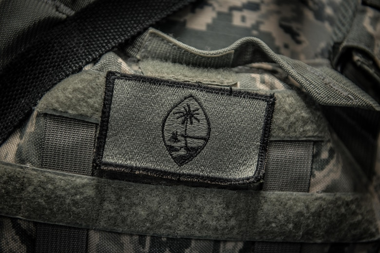 U.S. Air National Guard Tech. Sgt. Casey Morrison, a patrol team lead with the 407th Expeditionary Security forces Squadron, wears a small Guam flag patch on her tactical vest May 13, 2017, in Southwest Asia. Morrison is a traditional guardsman and deployed with a team from the 254th Security Forces Squadron in support of Operation Inherent Resolve. (U.S. Air Force photo by Staff Sgt. Alexander W. Riedel)