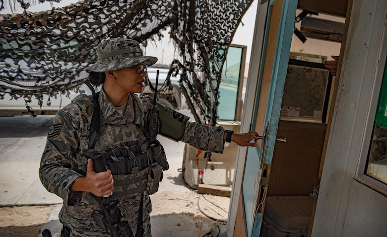 U.S. Air National Guard Tech. Sgt. Casey Morrison, a patrol team lead with the 407th Expeditionary Security Forces Squadron, enters a guard post May 13, 2017, in Southwest Asia. Morrison is a member of the 254th Security Forces Squadron at Andersen Air Force Base, Guam, and deployed to the Air Force Central Command region in support of Operation Inherent Resolve. She deployed with a team from the Guam ANG, which provides integrated base defense via base patrols and gate guard duties in defense of personnel assigned to the 407th Air Expeditionary Group. (U.S. Air Force photo by Staff Sgt. Alexander W. Riedel)