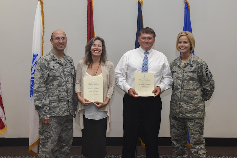 U.S. Air Force Col. Christopher Harris, 17th Mission Support Group Commander and Chief Master Sergeant Bobbie Riensche, 17th Training Wing command chief, present the Volunteer Excellence Award to Marla Ferguson, 17th Force Support Squadron and Jeffrey Draper, 17th Training Support Squadron at the Event Center on Goodfellow Air Force Base, Texas, June 1, 2017. The award is for exceptionally meritorious volunteer service to the United States Air Force community. (U.S. Air Force photo by Airman 1st Class Chase Sousa/Released)