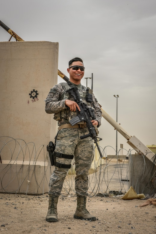 U.S. Air National Guard Airman 1st Class Randall Diego, a security forces member with the 407th Expeditionary Security Forces Squadron, smiles for a photo May 13, 2017, in Southwest Asia. Randall is a member of the 254th Security Forces Squadron at Andersen Air Force Base and volunteered for his first deployment right out of technical training. He is part of a team of Guam service members who deployed to the 407th AEG in support of Operation Inherent Resolve. (U.S. Air Force photo by Senior Airman Ramon Adelan)