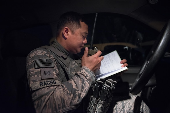U.S. Air National Guard Staff Sgt. Melquiadez Racho, a patrol team lead with the 407th Expeditionary Security forces Squadron, uses his radio to check in with the base defense operations center May 13, 2017, in Southwest Asia. During patrols, security forces defenders perform safety and welfare checks across base and check base fencelines and perimeters for anomalies. Racho is a traditional guardsman deployed from the 254th Security Forces Squadron at Andersen Air Force Base, Guam. When not on Air Force orders, Racho serves as a police instructor with the Department of Defense on Guam. (U.S. Air Force photo by Staff Sgt. Alexander W. Riedel)