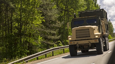 SALASPILS, Latvia-Marines with Combat Logistics Battalion 25, 4th Marine Logistics Group, Marine Forces Reserve, transport equipment and personnel by convoy from Ventspils to Adazi, Latvia, during Exercise Saber Strike 17, June 2, 2017.  Exercise Saber Strike 17 is an annual combined-joint exercise conducted at various locations throughout the Baltic region and Poland. The combined training prepares NATO Allies and partners to effectively respond to regional crises and to meet their own security needs by strengthening their borders and countering threats. (U.S. Marine Corps photo by Cpl. Devan Alonzo Barnett/Released)