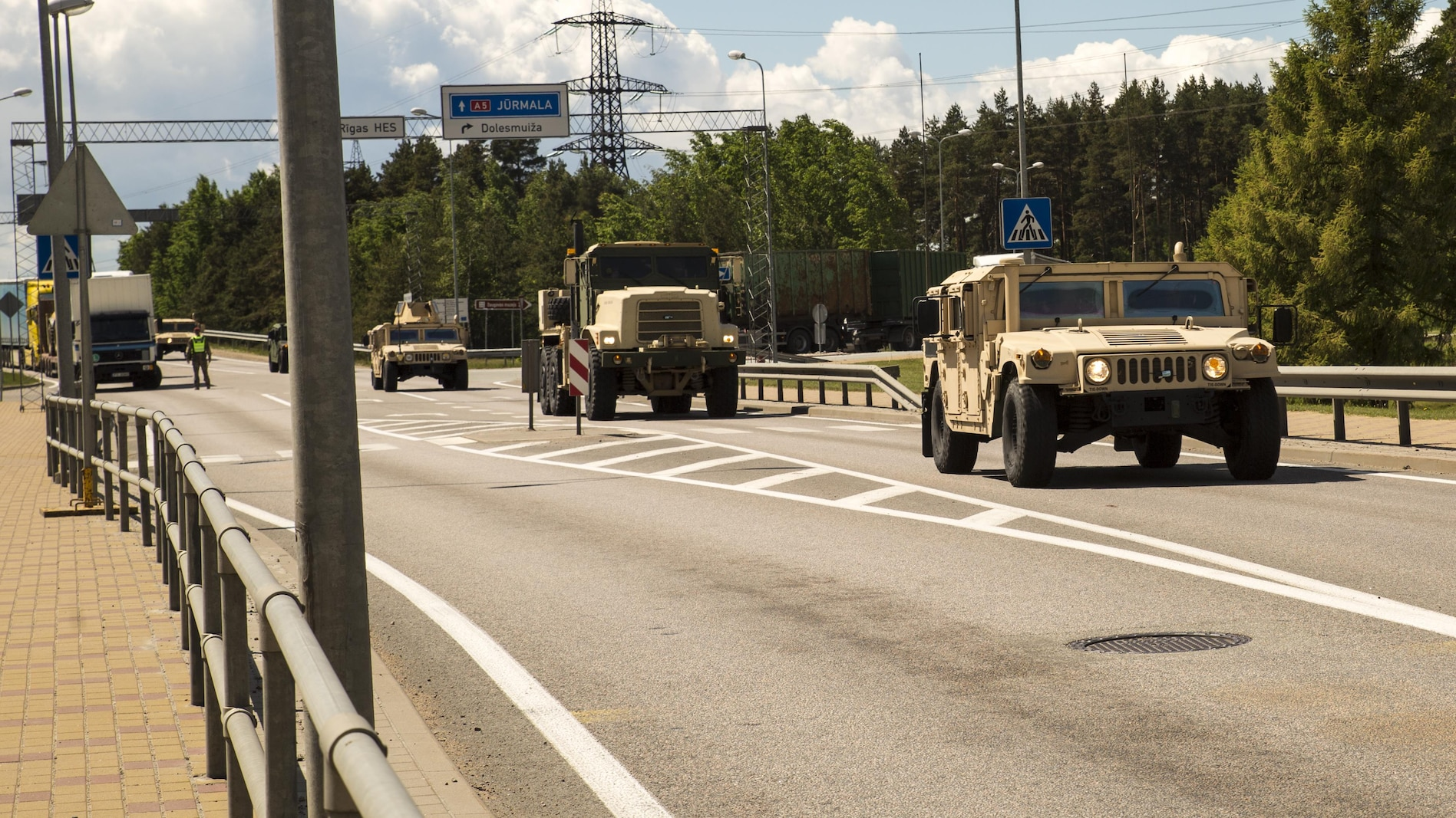SALASPILS, Latvia -- Marines with the Combat Logistics Battalion 25, 4th Marine Logistics Group, Marine Forces Reserve, transport equipment and personnel by convoy from Ventspils to Adazi, Latvia, during Exercise Saber Strike 17, June 2, 2017.  Exercise Saber Strike 17 is an annual combined-joint exercise conducted at various locations throughout the Baltic region and Poland. The combined training prepares NATO Allies and partners to effectively respond to regional crises and to meet their own security needs by strengthening their borders and countering threats. (U.S. Marine Corps photo by Cpl. Devan Alonzo Barnett/Released)