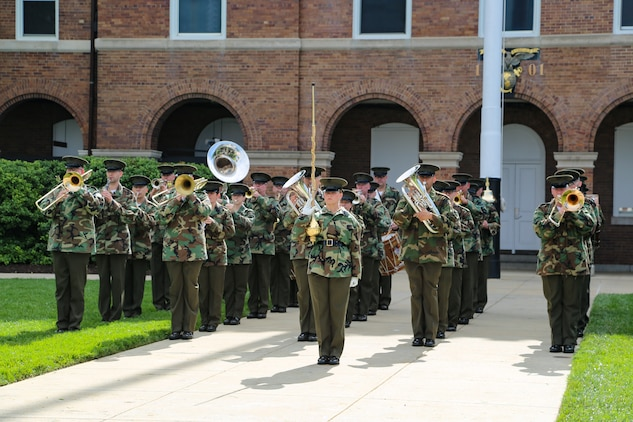 On Friday, May 26, 2017, Assistant Drum Major Gunnery Sgt. Stacie Crowther led the Marine Band during a parade rehearsal at Marine Barracks Washington. ((U.S. Marine Corps photo by Gunnery Sgt. Rachel Ghadiali/released)