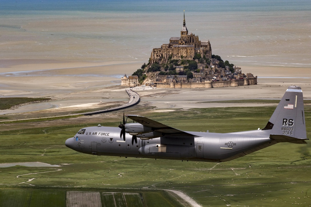 Air Force Brig. Gen. Richard G. Moore Jr. flies a C-130J Super Hercules past Mont Saint-Michel in Normandy, France