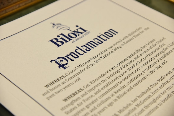 """A """"Col. Michele Edmondson Day"""" proclamation sits on display at Biloxi City Hall during a recognition ceremony for Col. Michele Edmondson, 81st Training Wing commander, May 30, 2017, in Biloxi, Miss. The Biloxi Mayor Andrew """"FoFo"""" Gilich hosted the ceremony, during a Biloxi city council meeting, to recognize Edmondson and her family for their support to the city during her assignment at Keesler. (U.S. Air Force photo by Kemberly Groue)"""