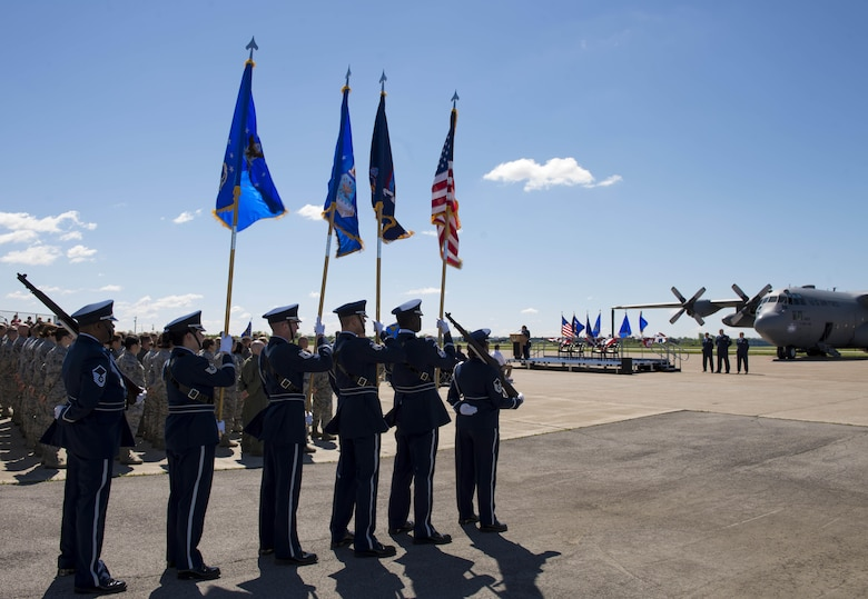 Members of the Niagara Falls Air Reserve Station Honor Guard stand at the ready, in the final moments before the 914th official Mission Change Ceremony in which the Airlift Wing will be re-designated as an Air Refueling Wing, June 3, 2017, Niagara Falls Air Reserve Station, N.Y. This transition marks the end of a 46-year mission, flying the C-130 aircraft. Under the new mission, the 914th will be flying the KC-135 Stratotanker. (U.S. Air Force photo by Tech. Sgt. Stephanie Sawyer)
