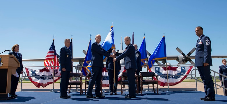 Col. Brian S. Bowman, 914th Air Refueling Wing Commander, relinquishes the 22nd Air Force flag to Brig. Gen. Steven B. Parker, 94th Airlift Wing Commander, Dobbins Air Reserve Base, GA, representing 22nd Air Force, during the Change of Mission Ceremony, June 3, 2017, Niagara Falls Air Reserve Station, N.Y. The Airlift Wing has been re-designated as an Air Refueling Wing, and as such, will fall under 4th Air Force moving forward. Under the new mission, the 914th will be flying the KC-135 Stratotanker. (U.S. Air Force photo by Tech. Sgt. Stephanie Sawyer)