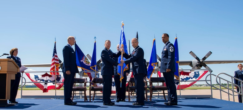 Col. Brian S. Bowman, 914th Air Refueling Wing Commander, accepts the 4th Air Force flag from Maj. Gen. Randall A. Ogden, 4th Air Force Commander, March Air Reserve Base, CA, during the Change of Mission Ceremony, June 3, 2017, Niagara Falls Air Reserve Station, N.Y. The Airlift Wing has been re-designated as an Air Refueling Wing, and as such, will fall under 4th Air Force moving forward. Under the new mission, the 914th will be flying the KC-135 Stratotanker. (U.S. Air Force photo by Tech. Sgt. Stephanie Sawyer)
