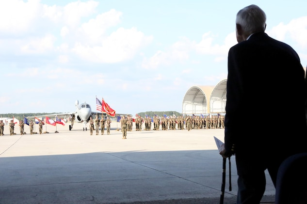 Retired Col. Thomas Murphree stands to honor the National Anthem during Marine Tactical Electronic Warfare Squadron 4's deactivation ceremony at Marine Corps Air Station Cherry Point, N.C., June 2, 2017. Tracing their lineage back to Marine Composite Reconnaissance Squadron One in the 1950's, VMAQ-4, Marine Aircraft Group 14, 2nd Marine Aircraft Wing, was activated Nov 7, 1981. Murphree is the former commanding officer of VMCJ-1, which evolved into VMAQ-4. (U.S. Marine Corps photo by Cpl. Jason Jimenez/ Released)