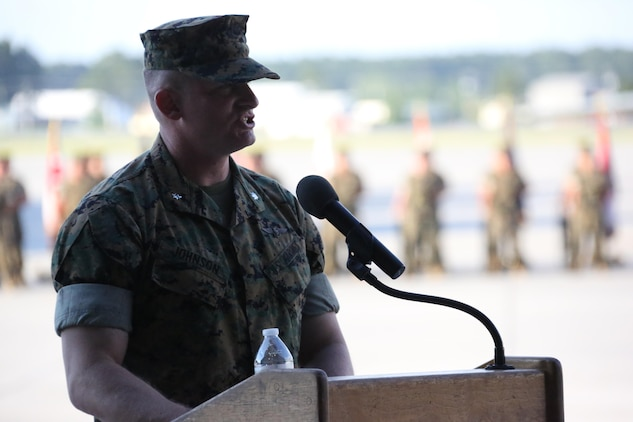 Lt. Col. Paul K. Johnson III addresses an audience during Marine Tactical Electronic Warfare Squadron 4's deactivation ceremony at Marine Corps Air Station Cherry Point, N.C., June 2, 2017. The squadron's mission was to support the Marine Air-Ground Task Force commander by conducting airborne electronic warfare, day or night, under all weather conditions during expeditionary, joint, or combined operations. Johnson is the commanding officer for VMAQ-4, Marine Aircraft Group 14, 2nd Marine Aircraft Wing. (U.S. Marine Corps photo by Cpl. Jason Jimenez/ Released)