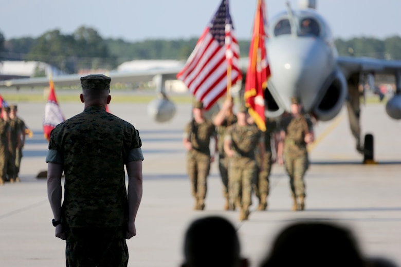"Lt. Col. Paul K. Johnson III awaits the squadron's color guard during Marine Tactical Electronic Warfare Squadron 4's deactivation ceremony at Marine Corps Air Station Cherry Point, N.C.,  June 2, 2017. ""This is a tough assignment to say goodbye to something so special,"" said retired Col. James Anderst, VMAQ-4, Marine Aircraft Group 14, 2nd Marine Aircraft Wing's first commanding officer. Johnson was the last commanding officer of VMAQ-4. (U.S. Marine Corps photo by Cpl. Jason Jimenez/ Released)"