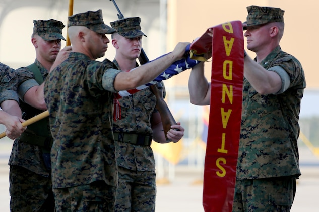 "Sgt. Maj Alex Narvaez, left, and Lt. Col. Paul K. Johnson III case the squadron colors during Marine Tactical Electronic Warfare Squadron 4's deactivation ceremony at Marine Corps Air Station Cherry Point, N.C., June 2, 2017. ""We have finished at the top of our game,"" said Johnson, the last commanding officer of VMAQ-4, Marine Aircraft Group 14, 2nd Marine Aircraft Wing. Narvaez was the sergeant major of VMAQ-4. (U.S. Marine Corps photo by Cpl. Jason Jimenez/ Released)"