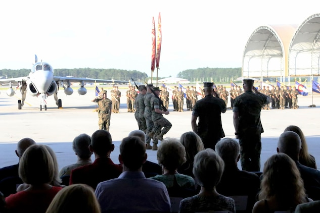Marines with Marine Tactical Electronic Warfare Squadron 4 salute the cased colors during the unit's deactivation ceremony at Marine Corps Air Station Cherry Point, N.C., June 2, 2017. In the last two years, VMAQ-4, Marine Aircraft Group 14, 2nd Marine Aircraft Wing, has supported two Red Flag exercises, two Weapons and Tactics Instructors courses, and a deployment to Turkey in support of Operation Inherent Resolve. VMAQ-4 was also recognized as the Marine Tactical Electronic Warfare Squadron of the year for 2016. (U.S. Marine Corps photo by Cpl. Jason Jimenez/ Released)