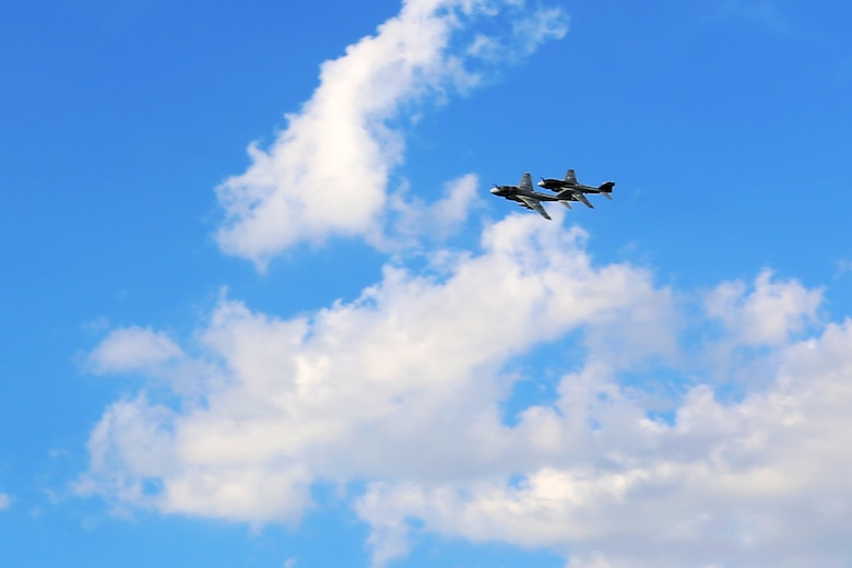 Two EA-6B Prowlers soar over Marine Tactical Electronic Warfare Squadron 4's deactivation ceremony at Marine Corps Air Station Cherry Point, N.C., June 2, 2017. Tracing their lineage back to Marine Composite Reconnaissance Squadron One in the 1950's, VMAQ-4, Marine Aircraft Group 14, 2nd Marine Aircraft Wing, was officially commissioned on Nov. 7, 1981. Back then, the Seahawks flew the EA-6A Electric Intruder until the transitioning to the EA-6B Prowler in the 1990's. (U.S. Marine Corps photo by Cpl. Jason Jimenez/ Released)