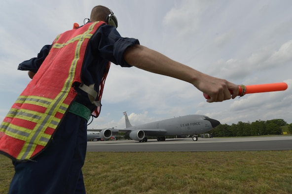 Staff Sgt. Joshua Kearney, 100th Aircraft Maintenance Squadron crew chief, marshalls a KC-135R Stratotanker
