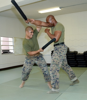 Sgt. Salvador Hernandez, left, martial arts instructor student, conducts a counter to a forward strike technique and then strikes Sgt. Frederick Graham during a Martial Arts Instructor Course aboard Marine Corps Logistics Base Albany, May 17.