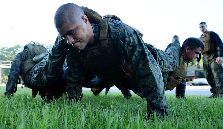 Martial arts instructor students conduct squad pushups during the culminating event of the Martial Arts Instructor Course aboard Marine Corps Logistics Base Albany, May 25.