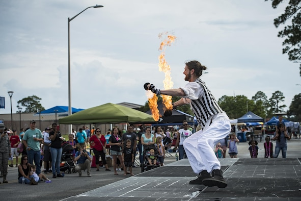 Charlie Wickboldt, a fire performer, dances with fire during the Moody Summer Block Party, June 2, 2017, at Moody Air Force Base, Ga. Members of Team Moody were encouraged to attend the event which offered a plethora of activities for all ages, including water slides, volleyball tournaments, a car show, and live entertainment. (U.S. Air Force photo by Senior Airman Janiqua P. Robinson)