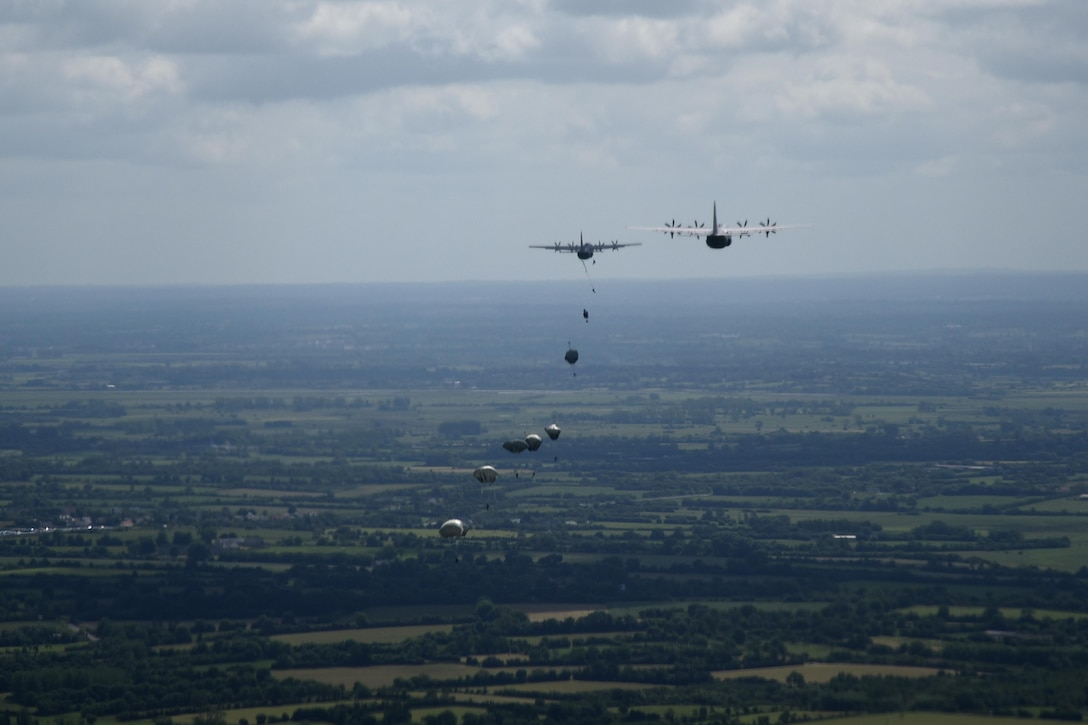 Paratroops jump from C-130J aircraft during a six-ship troop drop over Normandy, France. This event commemorates the 73rd anniversary of D-Day, the largest multi-national amphibious landing and operational military airdrop in history, and highlights the U.S.' steadfast commitment to European allies and partners. Overall, approximately 400 U.S. service members from units in Europe and the U.S. are participating in ceremonial D-Day events from May 31 to June 7, 2017(U.S. Air Force photo by Staff Sgt. Nicholas Monteleone)