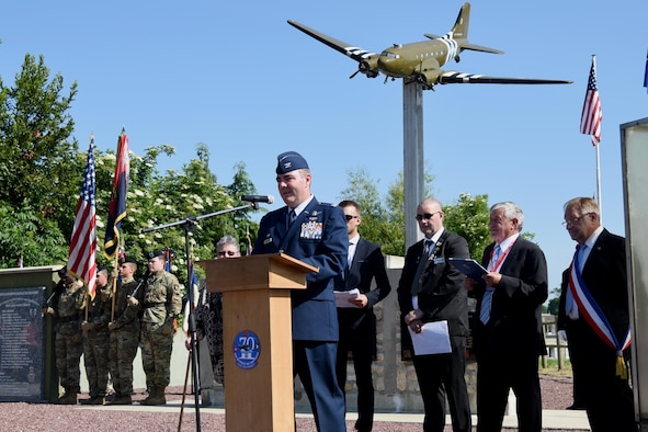 Col. Brian May, commander of the 403rd Operation Group, gives a speech during a ceremony in Picauville, France. This ceremony commemorates the 73rd anniversary of D-Day, the largest multi-national amphibious landing and operational military airdrop in history, and highlights the U.S.' steadfast commitment to European allies and partners. Overall, approximately 400 U.S. service members from units in Europe and the U.S. are participating in ceremonial D-Day events from May 31 to June 7, 2017(U.S. Air Force photo by Staff Sgt. Nicholas Monteleone)