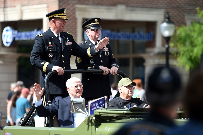 U.S. Army Reserve Brig. Gen. Frederick R. Maiocco Jr., (left) Commanding General, 85th Support Command, and Command Sgt. Maj. Vernon Perry III (right) Command Sergeant Major, 85th Support Command, wave to a crowd at the Village of Arlington Heights' Memorial Day parade on May 29, 2017. Arlington Heights was the last city in a three-day Memorial Day commemoration that Maiocco and Perry participated in the Chicago-land area. Both Maiocco and Perry said they were humbled by the amount of people who turned out to the events to show their support for the men and women who wear the uniform as well as the Gold Star Families. (U.S. Army photo by Sgt. Aaron Berogan/Released)