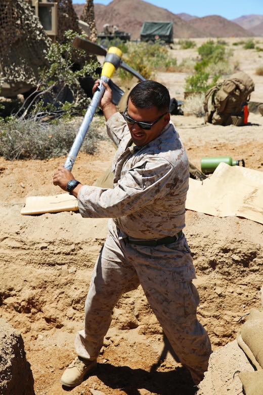 Cpl. Isaac Posadas, a motor transport mechanic with Marine Wing Support Squadron (MWSS) 373, digs a fighting hole during Integrated Training Exercise (ITX) 3-17 on Marine Corps Air Ground Combat Center Twentynine Palms, Calif., May 19. Marines with MWSS-373 fortified a forward aircraft refuel point as part of ITX, a combined-arms training exercise enabling Marines across 3rd Marine Aircraft Wing to operate as an aviation combat element integrated with ground and logistics combat elements as a Marine air-ground task force. More than 650 Marines and 27 aircraft with 3rd MAW are supporting ITX 3-17. (U.S. Marine Corps photo by Sgt. David Bickel/Released)