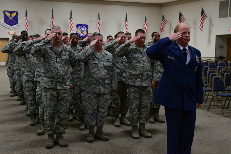 Airmen of the 307th Security Forces Squadron render the first salute to their new commander, Capt. Joel Brown, during an assumption of command ceremony on Barksdale Air Force Base, La., June 4, 2017. The Reserve Citizen Airmen of the squadron are trained to protect, defend and fight. (U.S. Air Force photo by Master Sgt. Dachelle Melville/Released)
