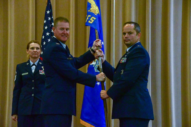 Col. William Rock, 307th Mission Support Group commander, passes the 307th Security Forces Squadron guidon to Capt. Joel Brown during an assumption of command ceremony on Barksdale Air Force Base, La., June 4, 2017. Brown is assuming command of the 307th SFS and brings additional experience to the unit from serving both as an enlisted Airman and an Army officer. (U.S. Air Force photo by Master Sgt. Dachelle Melville/Released)