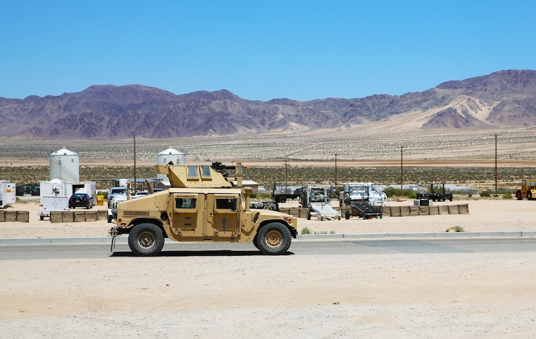 Marines with Marine Wing Support Squadron (MWSS) 373 return from their guard post and prepare to conduct an area damage assessment as part of the base recovery after attack training (BRAAT) evolution during Integrated Training Exercise (ITX) 3-17 at Marine Corps Air Ground Combat Center Twentynine Palms, Calif., May 23. ITX is a combined-arms exercise enabling Marines across 3rd Marine Aircraft Wing to operate as an aviation combat element integrated with ground and logistics combat elements as a Marine air-ground task force. More than 650 Marines and 27 aircraft with 3rd MAW are supporting ITX 3-17. (U.S. Marine Corps photo by Sgt. David Bickel/Released)