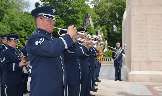 Airmen from the U.S. Air Forces in Europe Band play the national anthems of France and
