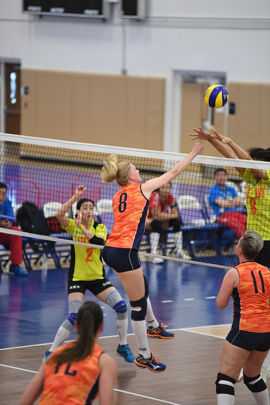 Dutch middle blocker Katelijne Van Houten spikes over her Chinese opponents in match 3 of the 18th Conseil International du Sport Militaire (CISM) World Women's Military Volleyball Championship at Naval Station Mayport, Florida on 5 June 2017. Mayport is hosting the CISM Championship from 2-11 June.  Finals are on 9 June.
