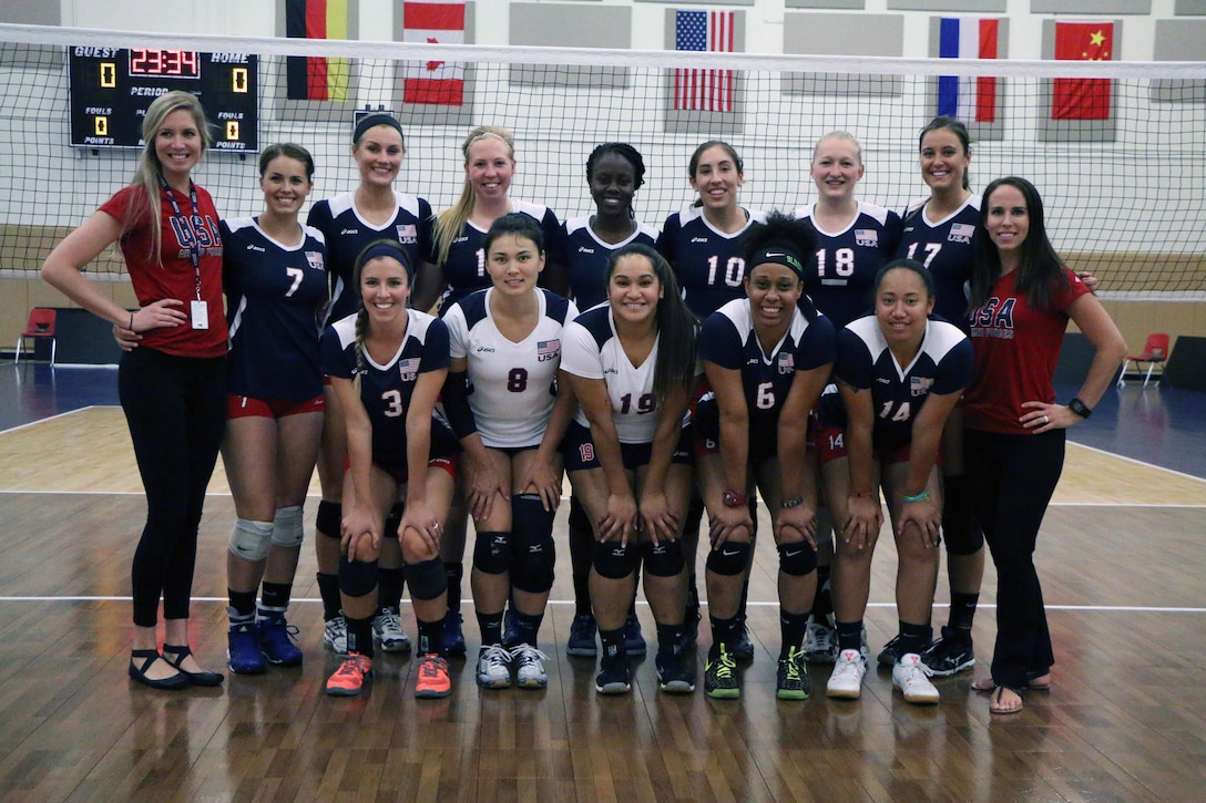 U.S. Armed Forces Team before their match against Canada during the 18th Conseil International du Sport Militaire (CISM) World Women's Military Volleyball Championship at Naval Station Mayport, Florida on 5 June 2017. Mayport is hosting the CISM Championship from 2-11 June.  Finals are on 9 June.  Left to Right: Back Row: Head Coach Mrs. Kara Lanteigne, Capt. Caroline Kurtz (USAF), 1st Lt. Megan Wilton (Army), 2nd lt. Taylor Parker (USAF), 1st Lt. Felicia Clement (USAF), Seaman Mary Lavery (USCG), Capt Abby Hall (USAF), 1st Lt. Molly McDonald (Army), Assistant Coach Mrs. Anna Renton; Front Row: Ensign Kirsten Kelso (Navy), 1st Lt. Maiya Perich (USAF), Seaman Denise Atualeavao (Navy), Sgt. Latoya Marshall (Army), and Petty Officer 3rd Class Angelina Pulu.