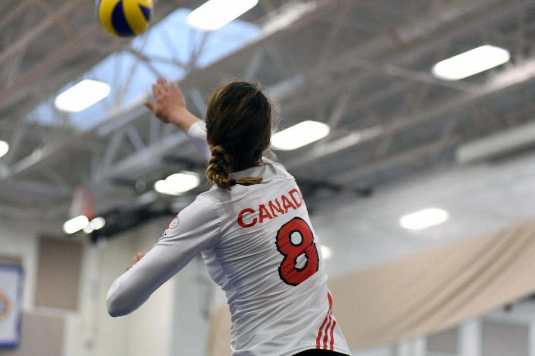 Canada's Middle Blocker Vanessa St. Georges serves in match 4 of the 18th Conseil International du Sport Militaire (CISM) World Women's Military Volleyball Championship at Naval Station Mayport, Florida on 5 June 2017. Mayport is hosting the CISM Championship from 2-11 June.  Finals are on 9 June.