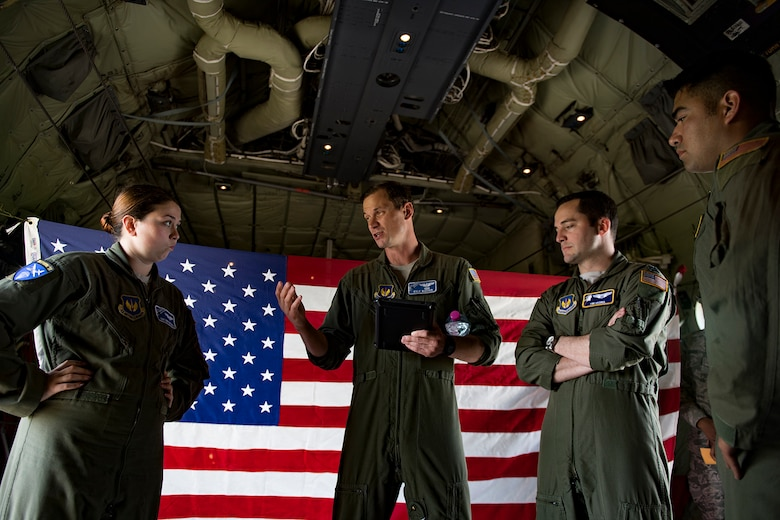 U.S. Air Force Maj. Kyle Bucher, 37th Airlift Squadron pilot, briefs his team before taking off in a C-130J Super Hercules assigned to the 37th AS at Ramstein Air Base, Germany, at Cherbourg-Maupertus Airport, France, June 2, 2017. The 37th AS performed flyovers over Normandy as part of the D-Day events. The events commemorate the 73rd anniversary of D-Day, the largest multinational amphibious landing and operational military airdrop in history, and highlights the U.S.' steadfast commitment to European allies and partners. Overall, approximately 400 U.S. service members from units in Europe and the U.S. are participating in ceremonial D-Day 73 events from May 31-June 7, 2017. (U.S. Air Force photo by Senior Airman Devin Boyer)