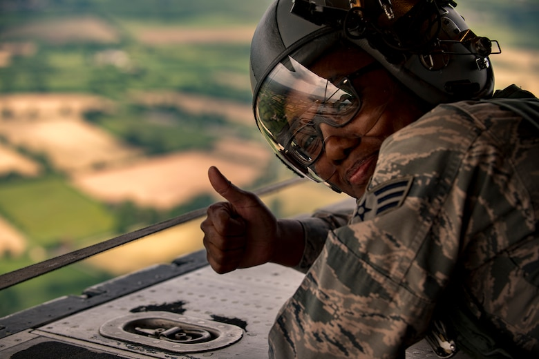 "U.S. Air Force Senior Airman Chasady Harris, 86th Operations Support Squadron aircrew flight equipment journeyman, gives a ""thumbs up"" while laying on the ramp of a C-130J Super Hercules assigned to the 37th AS at Ramstein Air Base, Germany, during a flyover in Normandy, France, June 2, 2017. The flyover commemorates the 73rd anniversary of D-Day, the largest multinational amphibious landing and operational military airdrop in history, and highlights the U.S.' steadfast commitment to European allies and partners. Overall, approximately 400 U.S. service members from units in Europe and the U.S. are participating in ceremonial D-Day 73 events from May 31-June 7, 2017. (U.S. Air Force photo by Senior Airman Devin Boyer)"