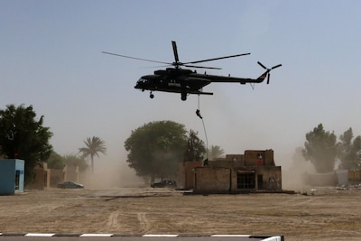 Iraqi special operations forces soldiers rappel out of an Iraqi helicopter during a demonstration by the Special Tactics Unit for Iraqi and coalition commanders in Baghdad, May 24, 2017. Army photo by Capt. Joseph M. Booth