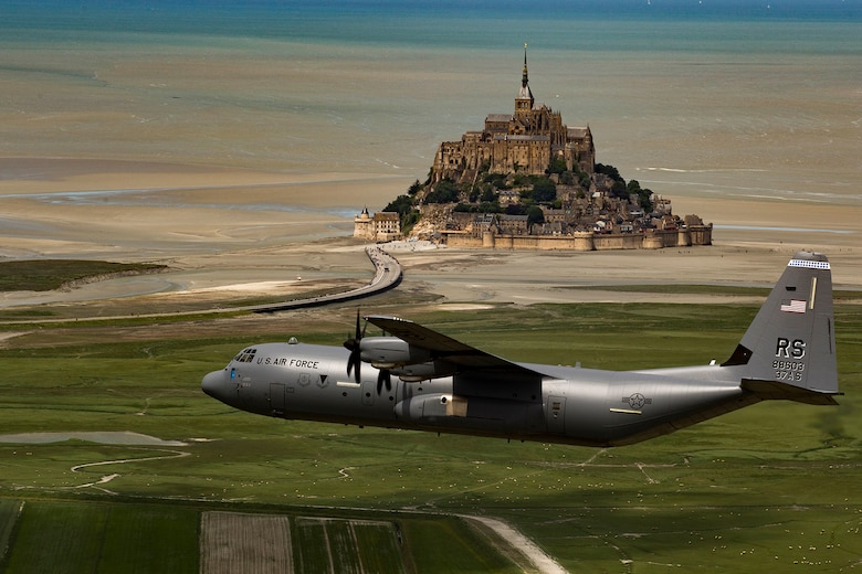 U.S. Air Force Brig. Gen. Richard G. Moore Jr., 86th Airlift Wing commander, flies a C-130J Super Hercules assigned to the 37th Airlift Squadron at Ramstein Air Base, Germany, past Mont Saint-Michel, France, June 3, 2017. This event commemorates the 73rd anniversary of D-Day, the largest multinational amphibious landing and operational military airdrop in history, and highlights the U.S.' steadfast commitment to European allies and partners. Overall, approximately 400 U.S. service members from units in Europe and the U.S. are participating in ceremonial D-Day 73 events from May 31-June 7, 2017. (U.S. Air Force photo by Senior Airman Devin Boyer)